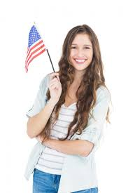 usa green card lottery female student holding american flag