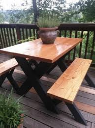 here s a really classy at a picnic table finished wood on top and black painted legs indoorlyfe com projects picnic tables picnics and