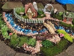 Small Picture Outdoor Fairy Garden With Small Houses Whimsical Outdoor Fairy