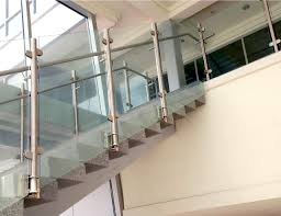 fascia mounted vista post supported glass railing with stainless steel d shaped glass clamps