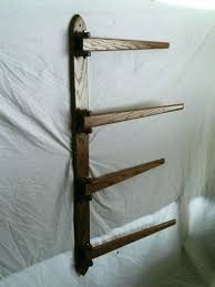 wall mounted quilt rack s hanging shelf wall mounted quilt rack