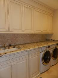 laundry room white cabinets and granite counter
