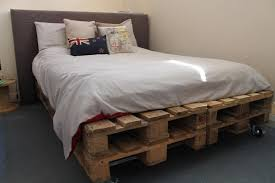 #13 SIMPLE WOODEN PALLET BED ON WHEELS
