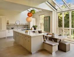 L Shaped White Kitchen Island Design With The Integrated Dining Area