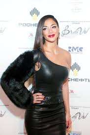 nicole flashed a smile in the fierce outfit