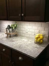 ice white granite paired with a beveled subway tile and mahogany cabinets