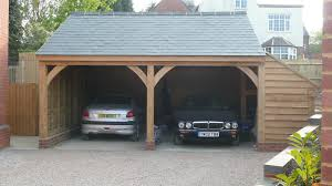 father and son decking complete cars in garage for first time