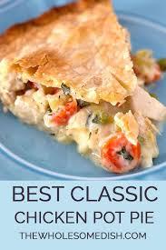slice of the best en pot pie recipe with creamy filling inside pie crust