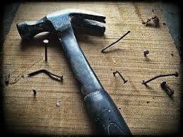 Image result for hammering nails wood