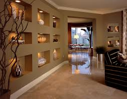 squared drywall wall niches paired with art lighting offer a unique display idea