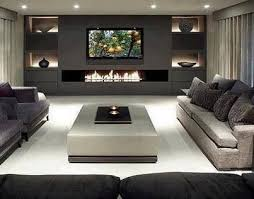 Contemporary dark wood floor and brown floor living room idea in Dallas  with white walls and