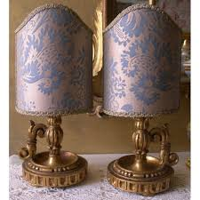 pair of antique italian gilt carved wood candlestick table lamps with slate blue gold fortuny