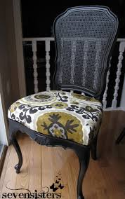 This DIY chair re-upholstering is FAB and SO EASY! Definitely doing this.