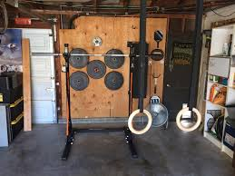first home gym with diy wall weight rack