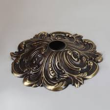 antique brass finish cast brass swirl canopy with 1 1 16 slip through hole