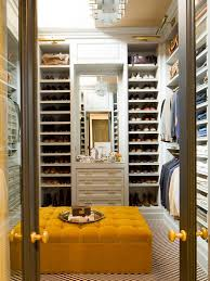 men walk-in closet behind transparent doors