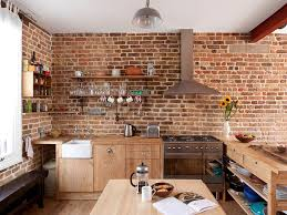 ... Contemporary kitchen in London with brick walls and wooden workstation  [Design: MDSX Contractors]