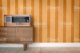 seventies furniture. vintage old radio on sixties seventies wallpaper and furniture royaltyfree stock photo