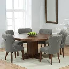 trina dark solid oak round dining table with 6 kalvin grey chairs 7020