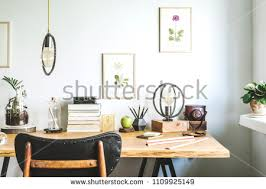 modern home office accessories. Modern Home Office Interior With Wooden Desk, Vintage Chair, Books, Laptop, Poster Accessories