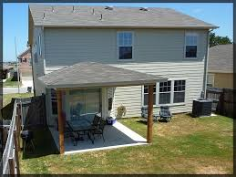 solid wood patio covers. Cool Patio Cover Design With Grey Roof And Wooden Solid Wood Column Plus Two Covers