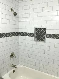 bathroom accent tiles large white subway tile with dark gray grout and gray accent tile in bathroom accent