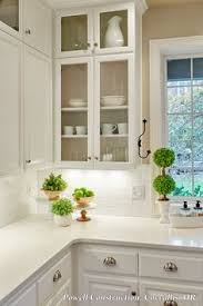 Need To Make Sure We Include Some Glass Front Cabinets For Abuela. This  Classic White Kitchen With Fresh Accents And Open, Glass Louvered Cabinets  And ...