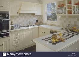Cream Kitchen Tile Black White Tiles In Tiled Worktop Of Peninsular Unit In Small