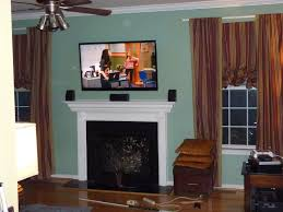 hanging lcd tv over gas fireplace ideas