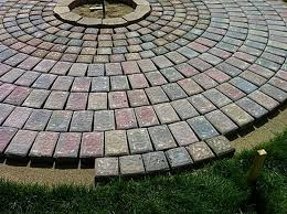 start with outlining the fire pit with fire pit blocks and work from the center outward with the pavers