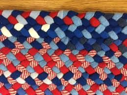 26 x 40 oval wool braided rug hand laced in red white and blue in hit miss style made with coat weight wool