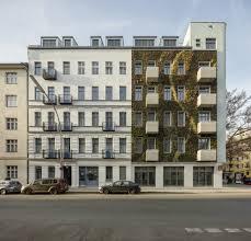 Urban apartment building with a green vertical garden