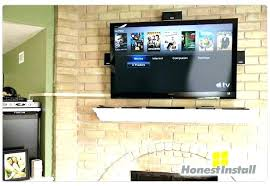 tv wall mount ideas hide wires mounting above brick fireplace how to hide wires over brick