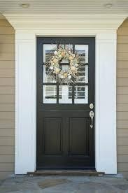 front door molding kit exterior door frame kit installation autumn wreath on a dark wood front
