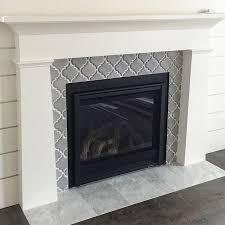 artisan arabesque grigio ceramic wall tile fireplace surround with a marble hearth