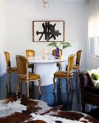 inspiring dining area clic yellow leather chairs sleek dark wood floors and attractive cowhide rug love the black floors