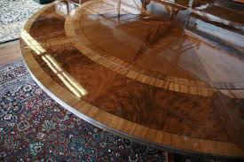 round dining table leaf. bright light will catch the tables finish and show lighter colors grain round dining table leaf l