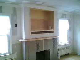 fireplace tv wall unit gas fireplaces with above built in wall entertainment units cabinetry stained wood fireplace tv wall unit