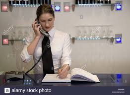 food server on the phone taking a reservation stock photo royalty food server on the phone taking a reservation
