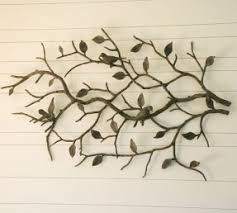a very attractive product that updates any room decor it is ideal for rooms with large empty walls this decoration has got a tree branch stylization  on metal wall art tree branches with metal birds wall art foter