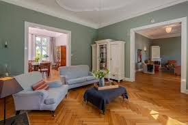 the herringbone parquet floors and stucco decorations are original the dining room