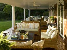 Brown Country Patio Seating on a covered veranda of a country-style  house.this is what I need to do on our porch.
