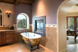 painting clawfoot tubs bathroom with painted tub and fireplace