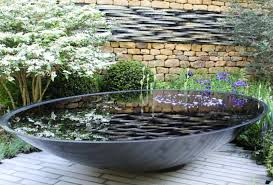 electricity is required to add a pump that creates the water flow but you can still create a beautiful water feature by using only a vessel and adding some