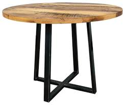 round reclaimed wood dining table with metal pedestal base