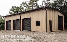 tan steel metal building with brown trim rollup doors