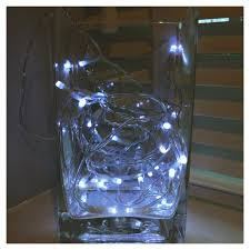 vase lighting. Vase Of Fairy Lights, Lights In Glass Vase, How To Decorate With Lighting