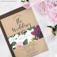 calligraphy based kraft paper invitations with a colorful blooming seed paper belly band