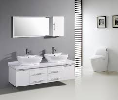 large bathroom mirror with storage above two raised sink wall mounted bathroom vanity near toilet under two framed pictures