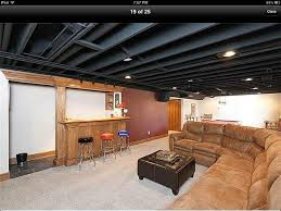 Paint basement ceiling infrastructure black to save money, really makes a  difference and looks good